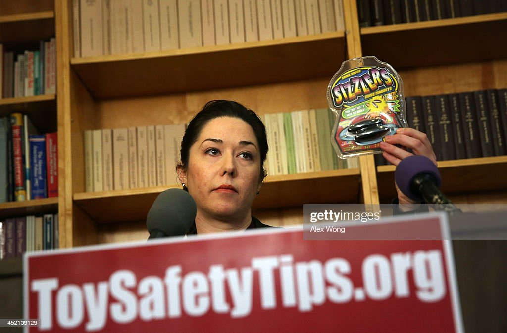 Public Health Advocate Jenny Levin holds up a pack of Sonic Sound Sizzlers Noise Magnets, a potentially hazardous magnet toy, as she speaks to members of the media on dangerous toys November 26, 2013 in Washington, DC. United States Public Interest Research Group (U.S. PIRG) released its 28th annual Trouble in Toyland report and list of dangerous toys to avoid this holiday season.