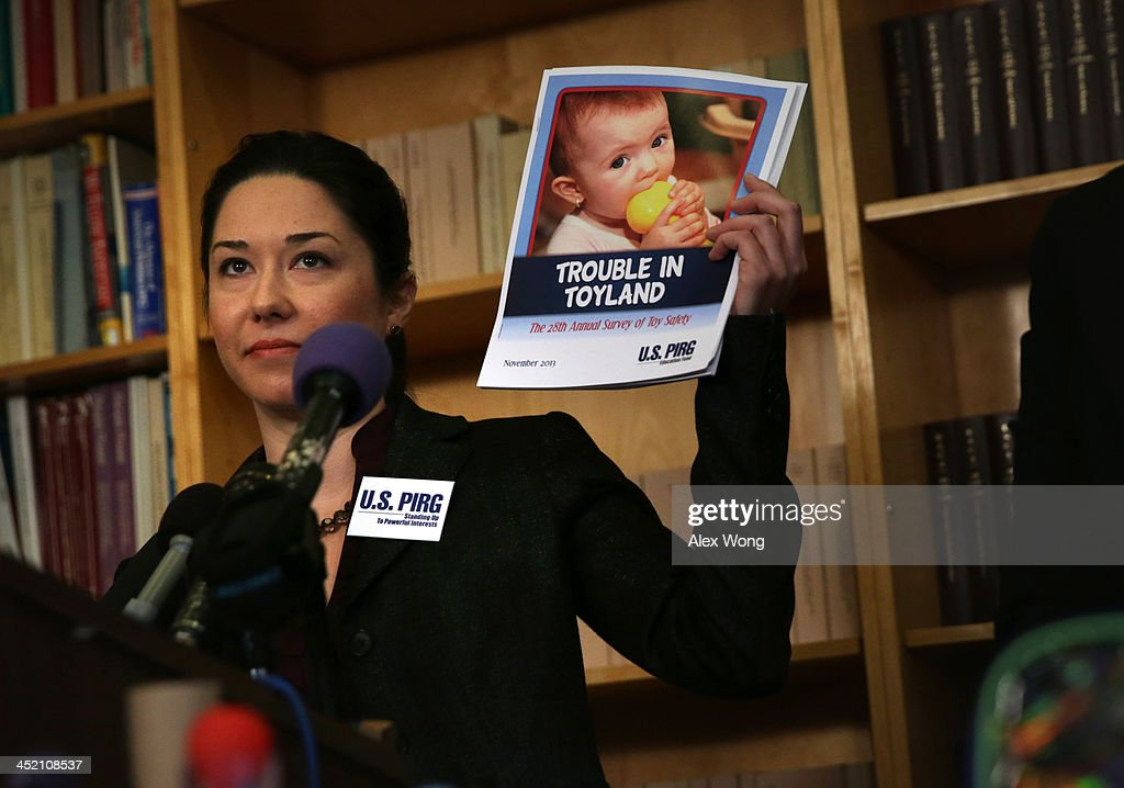 Public Health Advocate Jenny Levin holds up the Trouble in Toyland report as she speaks to members of the media on dangerous toys November 26, 2013 in Washington, DC. United States Public Interest Research Group (U.S. PIRG) released its 28th annual Trouble in Toyland report and list of dangerous toys to avoid this holiday season.