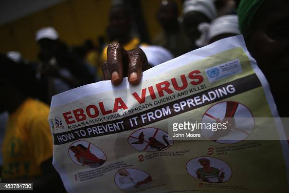 Public health advocates stage an Ebola awareness and prevention event on August 18 2014 in Monrovia Liberia The Liberian government and international...