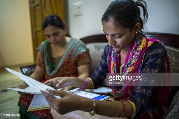 A Public Health Foundation of India worker right conducts a follow up with a patient during a free doortodoor screening program funded by Eli Lilly...