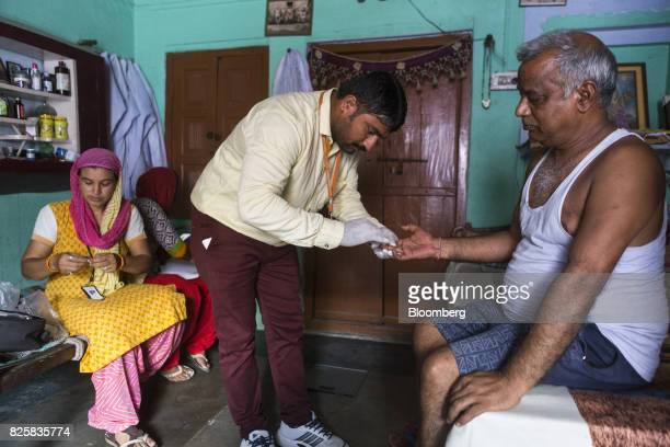 Public Health Foundation of India workers conduct a free doortodoor screening program funded by Eli Lilly Co at a home in the farming village of...