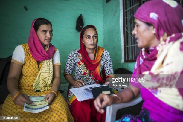 Public Health Foundation of India workers listen to a patient during a free doortodoor screening program funded by Eli Lilly Co at a home in the...