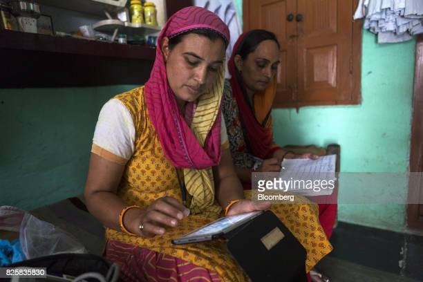 Public Health Foundation of India workers record test results during a free doortodoor screening program funded by Eli Lilly Co at a home in the...
