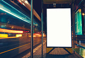 Illuminated blank billboard with copy space for your text message or content, advertising mock up banner of bus station,