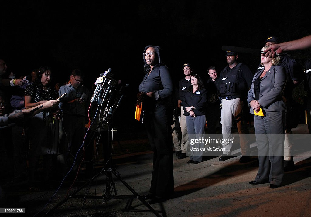 Public Information Officer Kristen Stancil (C) announces the completion of the execution of Troy Davis at Jackson State Prison on September 21, 2011 in Jackson, Georgia. Davis was executed on 11:08 pm ET Wednesday, September 21, 2011 for the 1989 slaying of off-duty Savannah, Ga., police officer Mark MacPhail. Controversy over Davis' guilt has drawn national attention to the case.