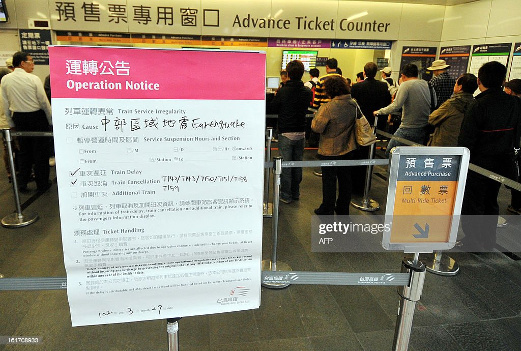 A public notice announcing disruptions to high-speed rail trains is displayed at Taipei's main station following an earthquake on March 27, 2013. A strong earthquake killed one person and injured 19 others in Taiwan on March 27 as violent shock waves damaged buildings and triggered a blaze, emergency officials said. AFP PHOTO / Mandy CHENG
