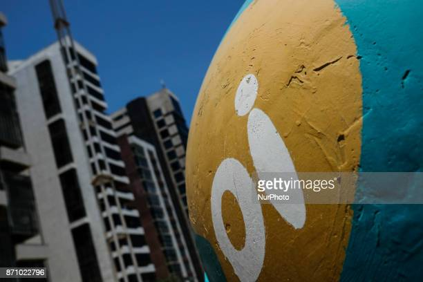 A public phone from Brazilian telephone operator Oi SA is seen between buildings in the city of Recife in northeast Brazil on November 6 2017...