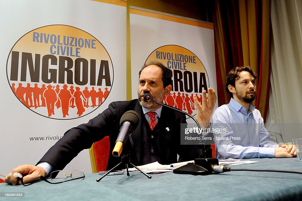 Public Prosecutor Antonio Ingroia (L) Premier candidate with Rivoluzione Civile party in the forthcoming Italian Parliamentary elections in Febraury meet Giovanni Favia (R) candidate of the same party during a meeting with their supporters at Hotel Europa on January 30, 2013 in Bologna, Italy.
