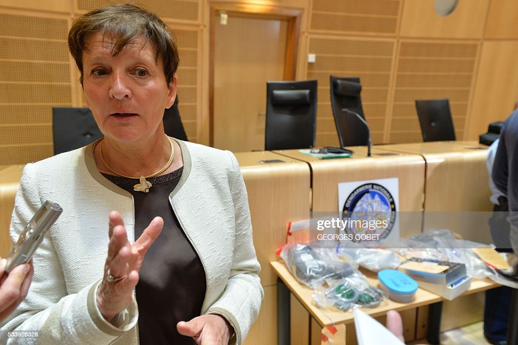 Public prosecutor Marie Madeleine Alliot answers journalists' questions during the display of objects used by a network of cash machine hackers in the courthouse of Bordeaux, southwestern France, on May 24, 2016. Eleven people belonging to a cash machine hacking network, suspected of pirating data from thousands of bank cards for a damage of around 1 million euros, have been arrested mid-May in the south of France, the Bordeaux prosecutor's office said on May 24, 2016. / AFP / GEORGES
