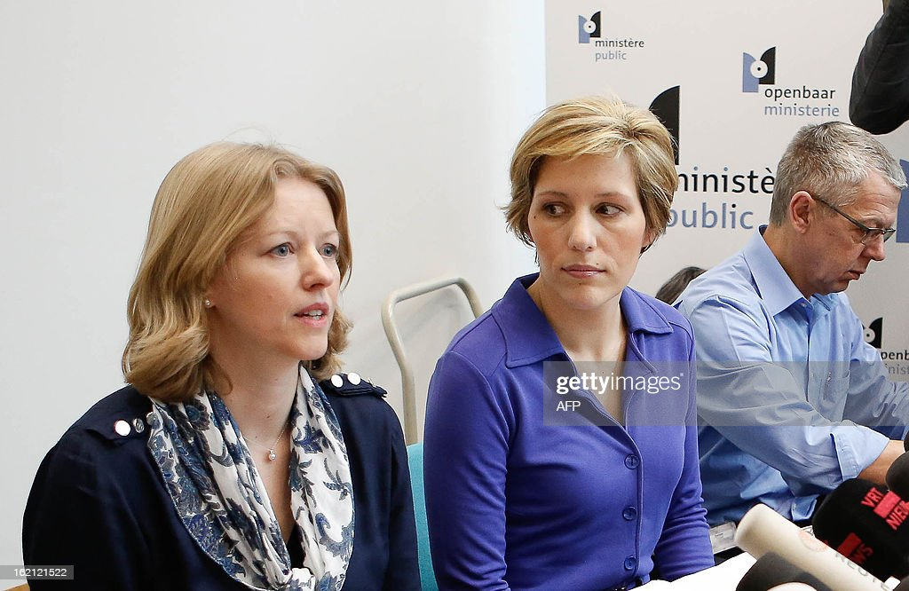 Public prosecutor's office employees Anja Bijnens and Ine Van Wijmersch talk to the press during in Zaventem on February 19, 2013 after heavily armed robbers made off with $50 million worth of diamonds in a massive heist at Brussels airport. Monday night's robbery was 'one of the biggest' ever, a spokeswoman for the Antwerp World Diamond Centre said, adding that the diamonds were 'rough stones' being transported from Antwerp to Zurich. AFP PHOTO / BELGA PHOTO BRUNO FAHY
