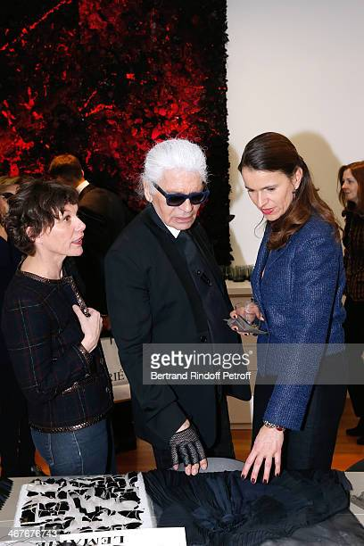 Public Relation crafts at Chanel Nathalie Vibert Fashion designer Karl Lagerfeld and French Culture Minister Aurelie Filippetti at the showroom of...