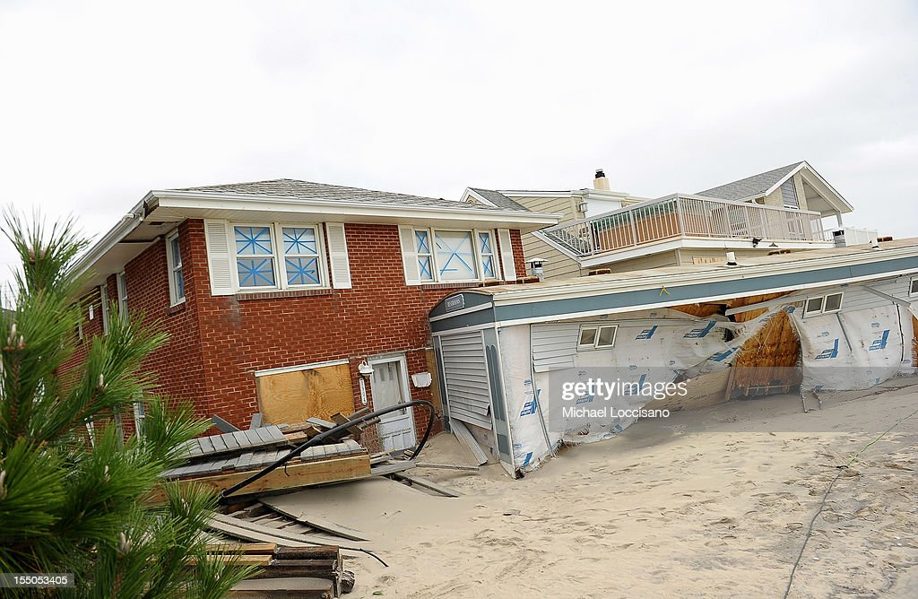 A public restroom, which was washed up against a property during tidal surges caused by Hurricane Sandy, on October 30, 2012 in Belmar, New Jersey, United States. With the death toll currently at 55 and millions of homes and businesses without power, the US east coast is attempting to recover from the affects of floods, fires and power outages brought on by Hurricane Sandy. JFK airport in New York and Newark airport in New Jersey expect to resume flights on Wednesday morning and the New York Stock Exchange commenced trading after being closed for two days.
