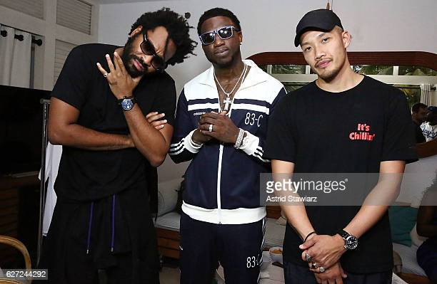 Public School designer Maxwell Osborne rapper Gucci Mane and Public School designer DaoYi Chow pose for photos at Public School And The Confidante...
