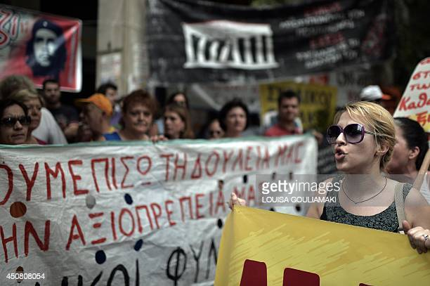 Public sector workers including health staff protest outside the ministry of finance in Athens during a 24hours hospital doctors strike on June 18...