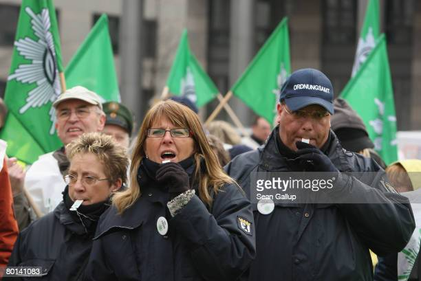 Public sector workers including members of the German police union demonstrate for better pay during strikes on March 6 2008 in Berlin Germany Tens...