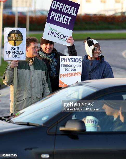 Public sector workers man a picket line at the entrance to the Forth Valley Royal Hospital in Larbert Scotland as workers around the country staged...
