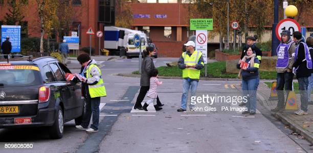 Public sector workers man a picket line outside St James Hospital in Leeds as workers went on general strike in a row over pensions