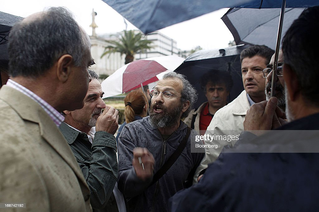 Public service unionists argue amongst themselves outside Athens University after the cancellation of a strike by state school workers in Athens, Greece, on Tuesday, May 14, 2013. Greek Prime Minister Antonis Samaras said the country can beat the targets set under its 240 billion-euro ($311 billion) International Monetary Fund and euro area bailout program and return to bond markets in the first half of next year. Photographer: Kostas Tsironis/Bloomberg via Getty Images