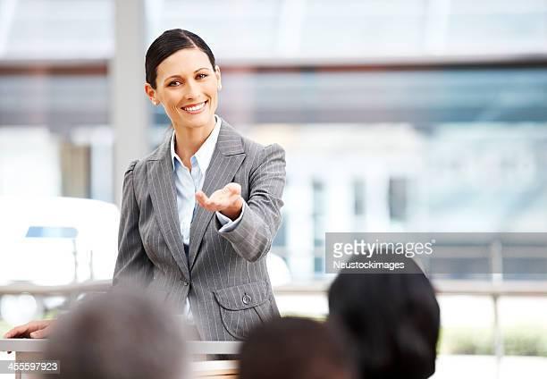 Public Speaker Calling on an Audience Member