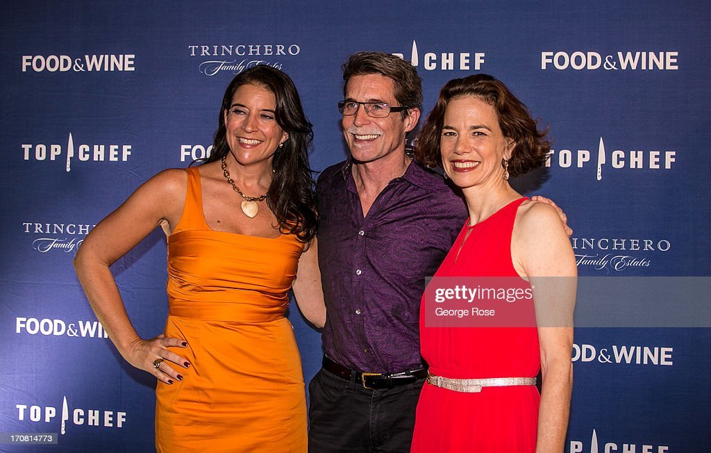 Public Television culinary star and owner of Chicago's Frontera Grill, Rick Bayless (C), poses with Food & Wine Magazine Publisher Christina Grdovic (L) and Editor-in-Chief Dana Cowin on June 13, 2013, in Aspen, Colorado. The 31st Annual Food & Wine Classic brings together the world's top chefs and vintners in a culinary and beverage celebration.