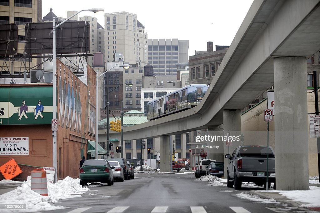 A public transportation system known as a People Mover moves above a street February 24, 2013 in Detroit, Michigan. The city of Detroit has faced serious economic challenges in the past decade, with a shrinking population and tax base while trying to maintain essential services. A financial review team issued a finding on February 19 identifying the city as being under a 'financial emergency.' Michigan Gov. Rick Snyder has 30 days from the report's issuance to officially declare a financial emergency, which could result in the governor appointing an emergency financial manager to oversee Detroit's municipal government.