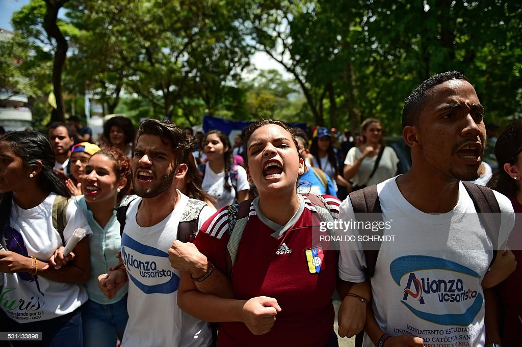Public university students in Venezuela opposed to President Nicolas Maduro protest against the governments policies, in Caracas on May 26, 2016. / AFP / RONALDO