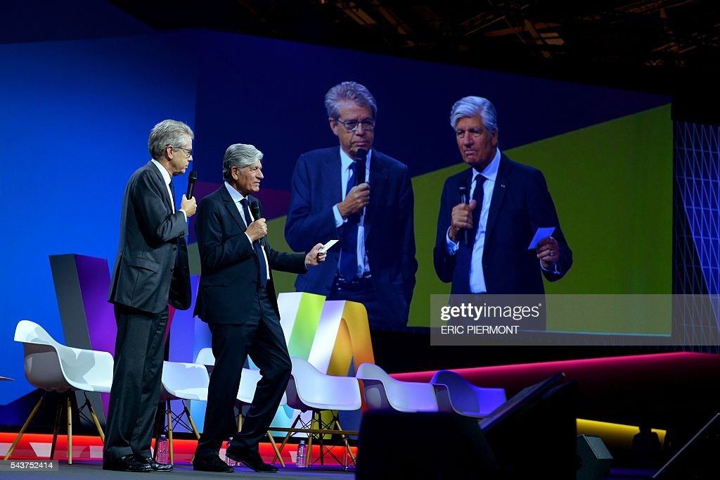Publicis Group Directory Board Chairman Maurice Levy (R) and Les Echos group CEO Francis Morel (L) addresse the opening of Viva Technology event in Paris on June 30, 2016. / AFP / ERIC