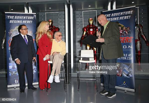 Publicist Jerry Olivarez JC Lee and comic book icon Stan Lee receive a proclamation from Clark County Commissioner Larry Brown at Marvel Avengers...