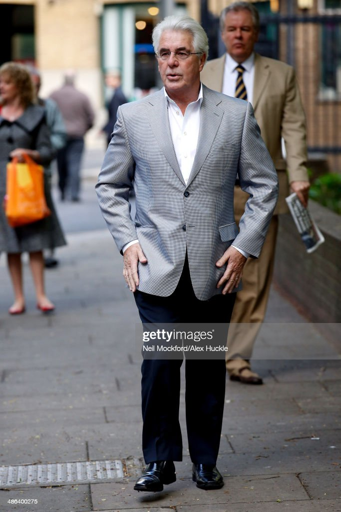 Publicist Max Clifford arrives at Southwark Crown Court on April 24 2014 in London England The jury has retired to consider the 11 charges of...