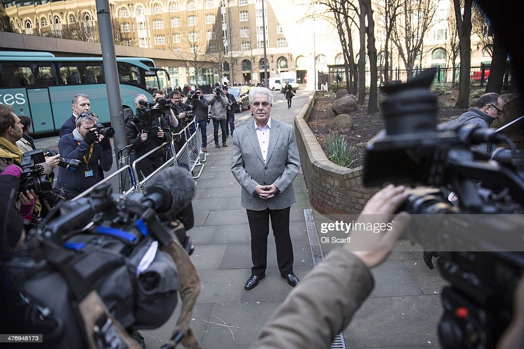 Publicist Max Clifford (C) arrives at Southwark Crown Court on March 6, 2014 in London, England. Mr Clifford, a public relations expert, has pleaded not guilty to 11 charges of indecent assault.