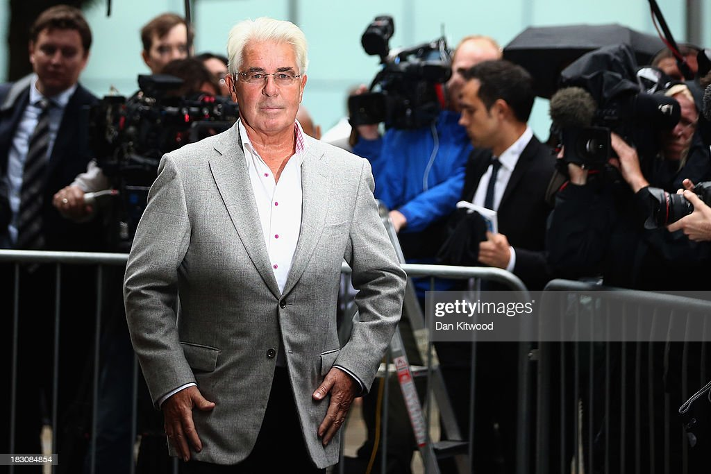 Publicist Max Clifford speaks to the press after leaving Southwark Crown court on October 4, 2013 in London, England. Max Clifford pleaded not guilty when appearing at court charged with 11 indecent assaults, allegedly committed between 1966 and 1985. Mr Clifford was arrested at his home in Surrey in December 2012 by officers from Operation Yewtree, following up on allegations in the wake of the Jimmy Savile scandal.