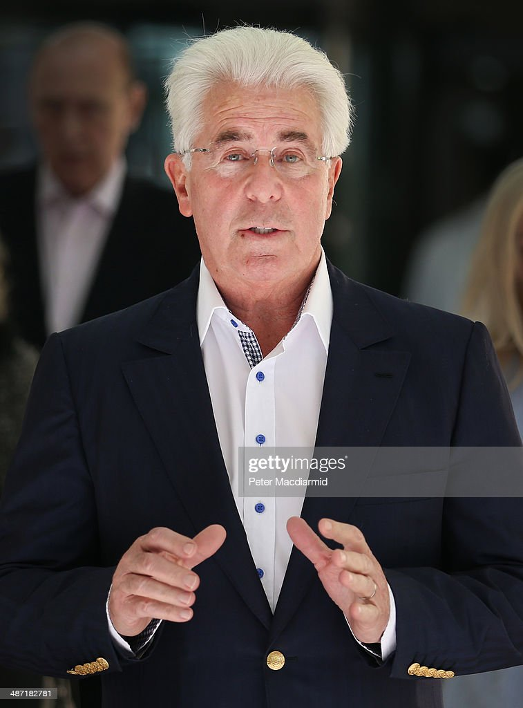 Publicist Max Clifford talks to reporters as he leaves Southwark Crown Court on April 28 2014 in London England Mr Clifford has been found guilty of...