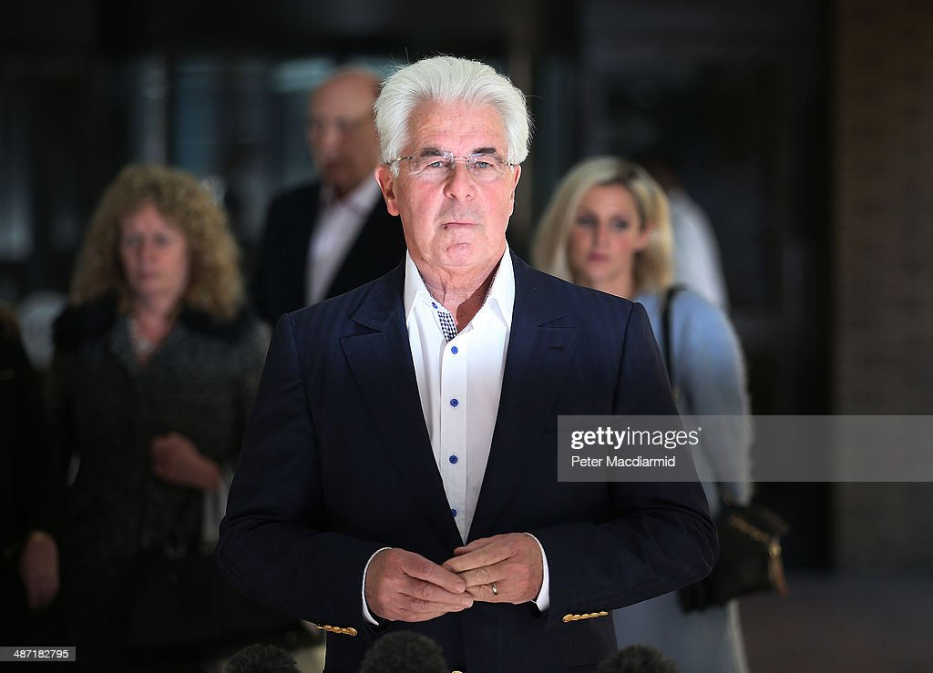Publicist Max Clifford talks to reporters as he leaves Southwark Crown Court on April 28, 2014 in London, England. Mr Clifford has been found guilty of eight indecent assaults on women and girls as young as 15 by a jury at Southwark Crown Court.