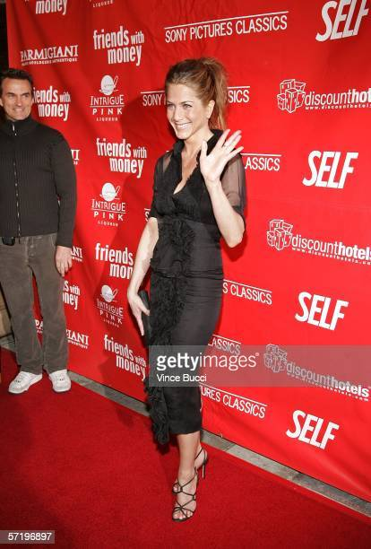 Publicist Stephen Huvane looks on as actress Jennifer Aniston arrives at the Sony Pictures Classics premiere of the film 'Friends with Money' held at...