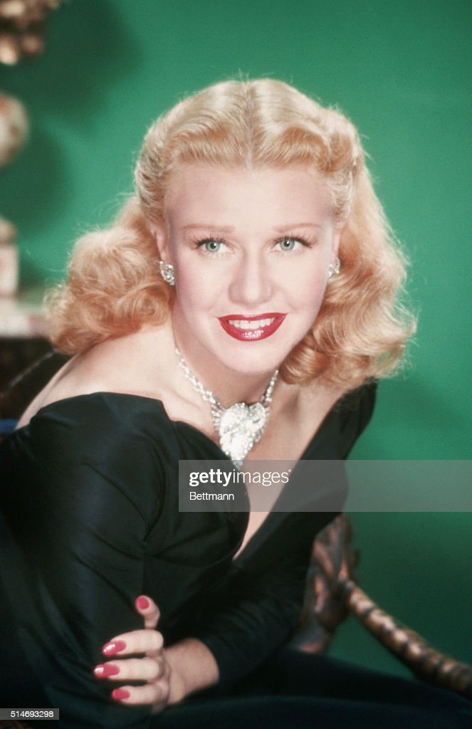 Publicity handout of actress <a gi-track='captionPersonalityLinkClicked' href=/galleries/search?phrase=Ginger+Rogers&family=editorial&specificpeople=93466 ng-click='$event.stopPropagation()'>Ginger Rogers</a>. She is shown from the waist-up and wears a black low-cut dress and sparkly necklace. Undated color slide.