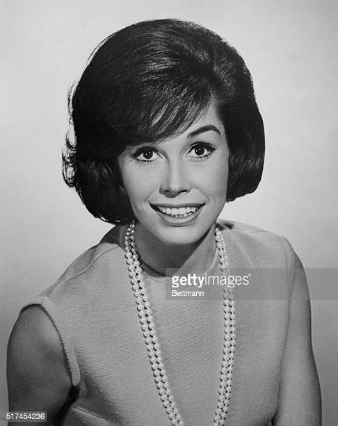 Publicity handout of smiling television actress Mary Tyler Moore shown from the waist up circa 1970 She is wearing a sleeveless sweater and a double...