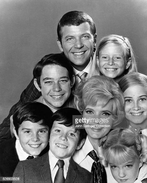 Publicity handout of the cast of 'The Brady Bunch' television series all beaming with their heads stacked on top of each other Ca 1970s