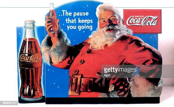 Publicity of Christmas for Coca cola publishing in 1934 and realised by Haddon Sundblom who works for Coca in 1931 to 1960