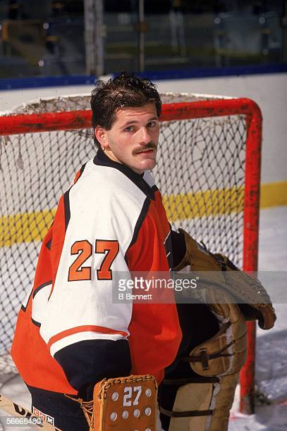 Publicity photograph of Canadian professional hockey player Ron Hextall goalie for the Philadelphia Flyers who poses on the ice in front of the goal...