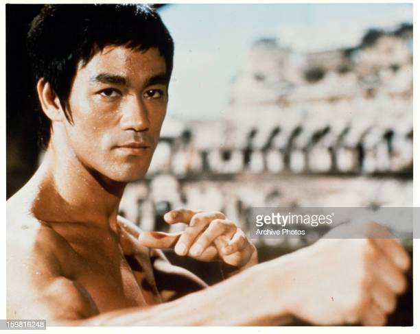 Bruce Lee in a martial arts position in a scene from the film 'Enter The Dragon' 1973