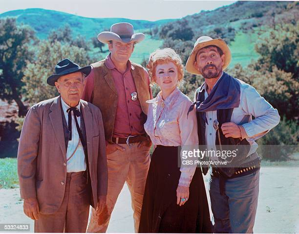 Publicity portrait of the cast of the American television series 'Gunsmoke' June 1970 From left American actors Milburn Stone James Arness Amanda...