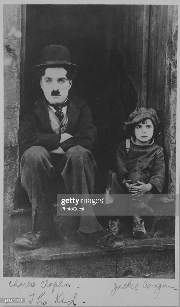 Publicity still of British actor <a gi-track='captionPersonalityLinkClicked' href=/galleries/search?phrase=Charlie+Chaplin&family=editorial&specificpeople=70006 ng-click='$event.stopPropagation()'>Charlie Chaplin</a> (1889 - 1977) (left) and American child actor <a gi-track='captionPersonalityLinkClicked' href=/galleries/search?phrase=Jackie+Coogan&family=editorial&specificpeople=93568 ng-click='$event.stopPropagation()'>Jackie Coogan</a> (1914 - 1984) as they sit in a doorway in the film 'The Kid' (directed by Chaplain), California, 1921.