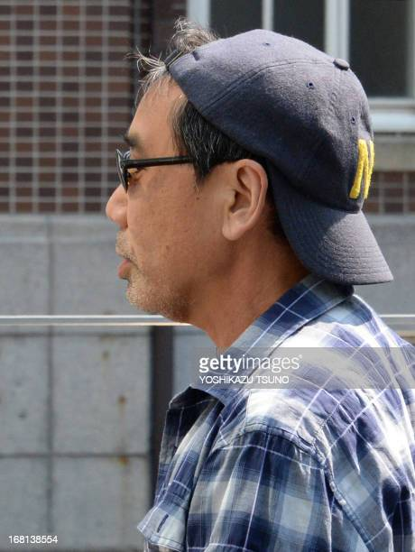 Publicityshy Japanese author Haruki Murakami arrives to give a public lecture in Kyoto on May 6 2013 The author whose new novel 'Shikisai wo Motanai...