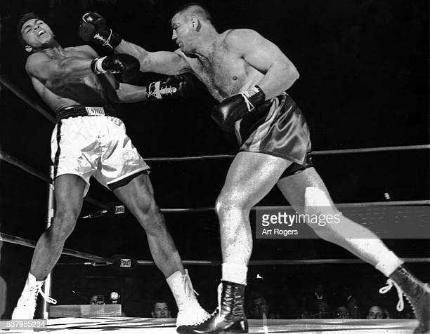 April 24 1962LOGAN ON ATTACKGeorge Logan bulls Cassius Clay into ropes and lands right during first round action at Sports Arena This was Logan's...