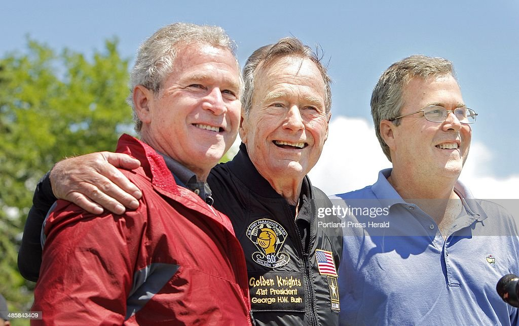 CORRECTION published Sunday June 14 2009 A photo cutline on Page A11 Saturday should have said former President George H W Bush poses with his sons...