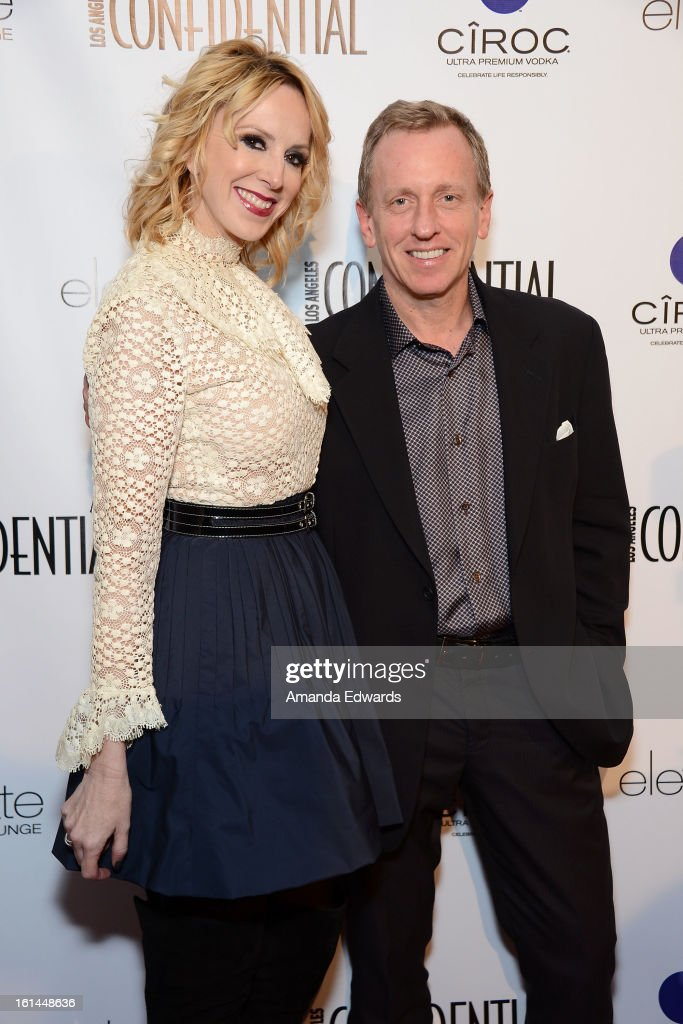 Publisher Alison Miller (L) and Los Angeles Confidential Editor-in-Chief Spencer Beck arrive at the Los Angeles Confidential and Harmony Project GRAMMY after party honoring Mary J. Blige at Elevate Lounge on February 10, 2013 in Los Angeles, California.