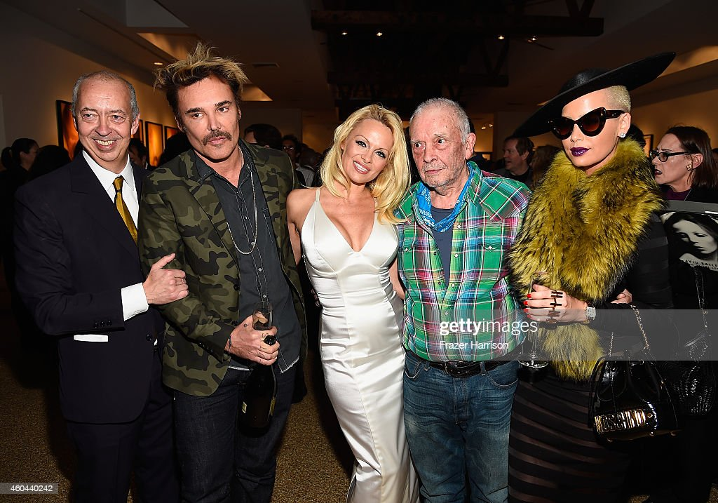 Publisher <a gi-track='captionPersonalityLinkClicked' href=/galleries/search?phrase=Benedikt+Taschen&family=editorial&specificpeople=2136234 ng-click='$event.stopPropagation()'>Benedikt Taschen</a>, photographer <a gi-track='captionPersonalityLinkClicked' href=/galleries/search?phrase=David+LaChapelle&family=editorial&specificpeople=204135 ng-click='$event.stopPropagation()'>David LaChapelle</a>, actress <a gi-track='captionPersonalityLinkClicked' href=/galleries/search?phrase=Pamela+Anderson&family=editorial&specificpeople=171759 ng-click='$event.stopPropagation()'>Pamela Anderson</a>, photographer <a gi-track='captionPersonalityLinkClicked' href=/galleries/search?phrase=David+Bailey+-+Photographer&family=editorial&specificpeople=216323 ng-click='$event.stopPropagation()'>David Bailey</a> and model <a gi-track='captionPersonalityLinkClicked' href=/galleries/search?phrase=Amber+Rose+-+Model&family=editorial&specificpeople=2025513 ng-click='$event.stopPropagation()'>Amber Rose</a> attend TASCHEN And <a gi-track='captionPersonalityLinkClicked' href=/galleries/search?phrase=David+Bailey+-+Photographer&family=editorial&specificpeople=216323 ng-click='$event.stopPropagation()'>David Bailey</a> Celebrate 'It's Just A Shot Away: The Rolling Stones In Photographs' at the TASCHEN Gallery on December 13, 2014 in Los Angeles, California.