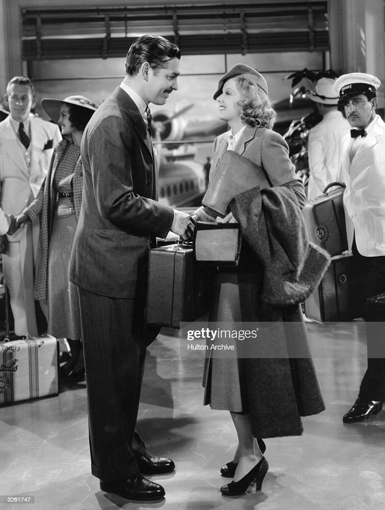 Publisher Clark Gable (1901 - 1960) and secretary Jean Harlow (1911 - 1937) in a scene from 'Wife Vs Secretary,' a comedy drama about a wife who starts to believe rumours about her husband's attraction to his secretary. The film was directed by Clarence Brown for MGM.