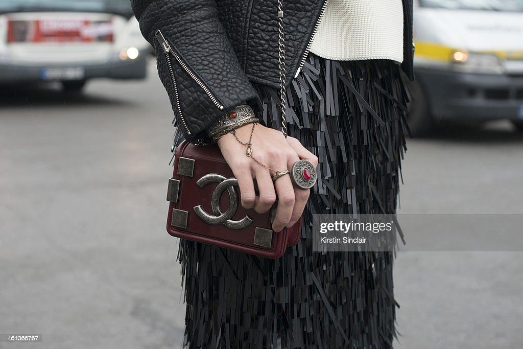 Publisher for Euro 24/7 Kazakhstan Meruyert Ibragim wears a Chanel bag Prada skirt Celine sweater and jacket day 2 of Paris Haute Couture Fashion...