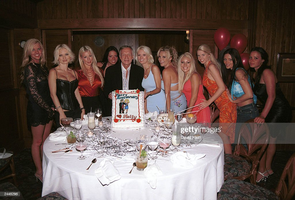 Publisher Hugh Hefner and Girlfriend Holly Madison's (C) with his Playmates, including some candidates for the 50th Anniversary Playmate, pose inside Trader Vic's for their 2nd anniversary August 28, 2003 in Beverly Hills, California.